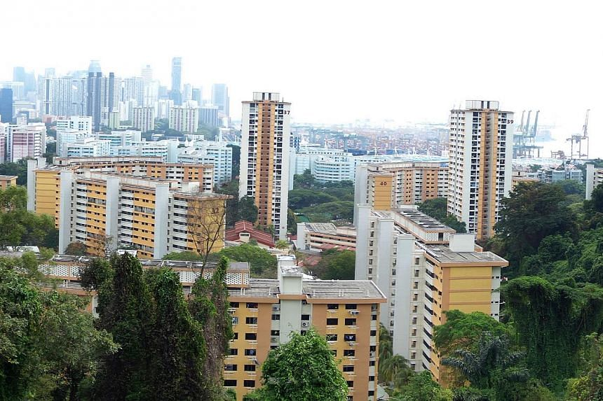"""HDB flats as seen from Mount Faber (left). Mr Khaw (right) has mooted giving """"absolute priority"""" to those applying for BTO flats in the same area as their parents but some worry they will want the flat just for its premium location."""