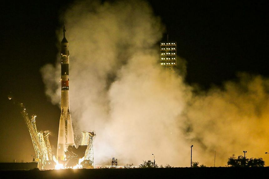 The Soyuz TMA-13M rocket is launched with Expedition 40 Soyuz Commander Maxim Suraev, of the Russian Federal Space Agency, Roscosmos, Flight Engineer Alexander Gerst, of the European Space Agency, ESA, and Flight Engineer Reid Wiseman of NASA from th
