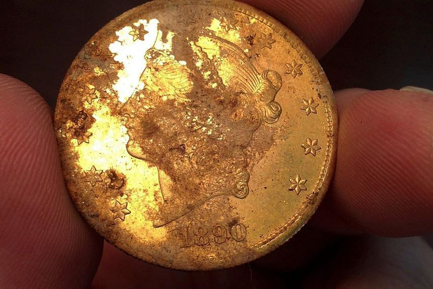 A California couple who unearthed a treasure trove on their property are at least US$1 million (S$1.25 million) richer after buyers seized on the ancient gold coins sold at auction. -- PHOTO: AFP