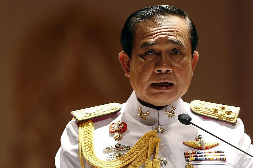 Thai Army chief General Prayuth Chan-ocha addresses reporters at the Royal Thai Army Headquarters in Bangkok on May 26, 2014. -- PHOTO: REUTERS