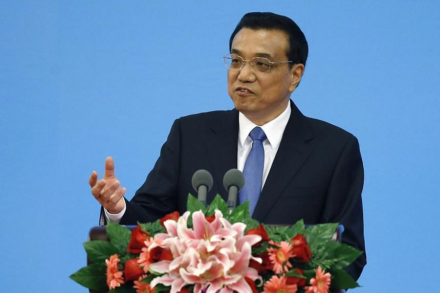 Chinese Premier Li Keqiang delivers a speech during the opening ceremony of the Annual Meeting of Global Research Council at the Great Hall of the People in Beijing on May 27, 2014. Mr Li said that China would adopt moderate fine tuning of its econom