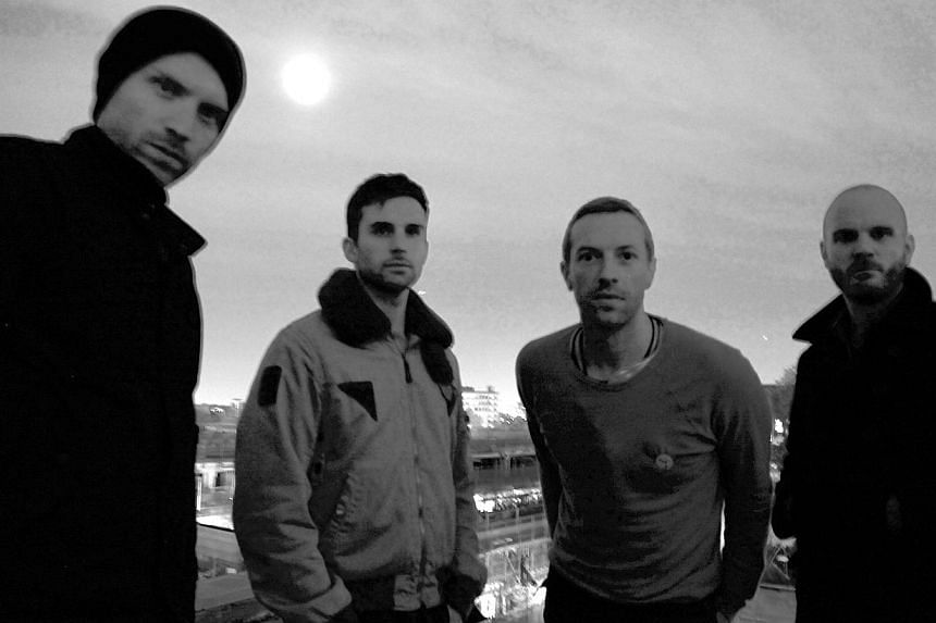 Music indie group Coldplay includes Chris Martin (third from left) being the frontman who has a new album, Ghost Stories. -- PHOTO: PARLOPHONE