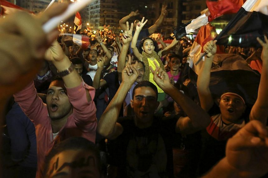 Supporters of Abdel Fattah al-Sisi celebrate at Tahrir square in Cairo on May 28, 2014. -- PHOTO: REUTERS