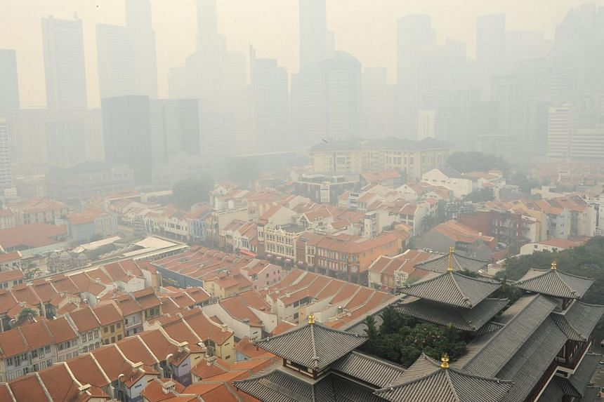 Singapore shrouded in haze on June 20, 2013. -- PHOTO: AFP