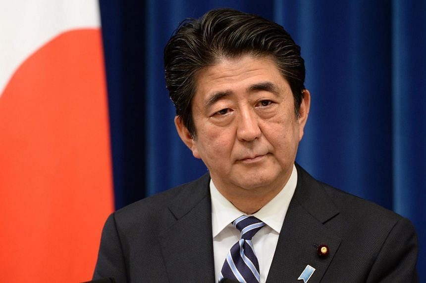 Japan's Prime Minister Shinzo Abe delivers a speech during a press conference at his official residence in Tokyo on May 15, 2014. Mr Abe's message of a bigger global security role for Japan when he speaks at a regional forum this week is likely to fi