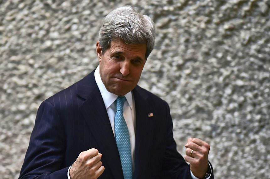 US Secretary of State John Kerry gestures after a conference in the framework of the Cleantech Challenge Mexico 2014, in Mexico City, on May 21, 2014. Mr Kerry lashed out at fugitive Edward Snowden on Wednesday, urging him to man-up and do his patrio