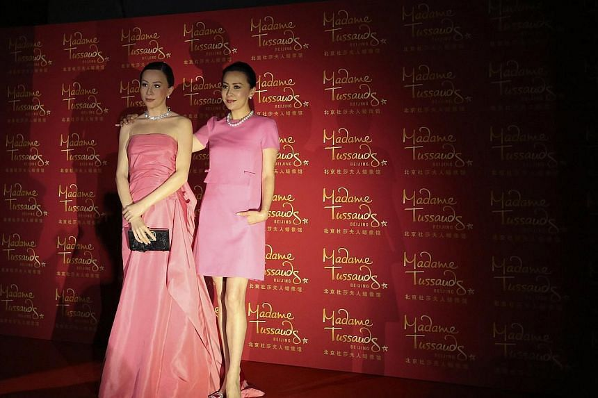 Hong Kong actress Carina Lau (R) poses next to a wax figure of herself during an unveiling ceremony at a new Madame Tussauds Museum in Beijing, May 29, 2014. The new museum, the 16th in the world and the 4th in China, will be opened to public on May