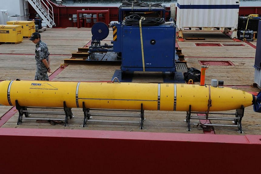 The Phoenix Autonomous Underwater Vehicle Artemis Bluefin-21 on the deck of the Australian navy ship Ocean Shield, berthed at Fleet Base West near Perth on May 5, 2014. -- PHOTO: AFP