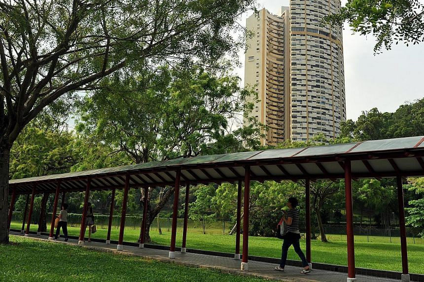 Commuters residing in north-eastern and north-western Singapore will soon get sheltered walkways that stretch up to 400m from 59 MRT stations. -- PHOTO: ST FILE