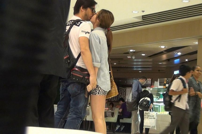 Director Oxide Pang was caught kissing model Liddy Li in a queue for movie tickets in Hong Kong on May 23, 2014. -- PHOTO: APPLE DAILY