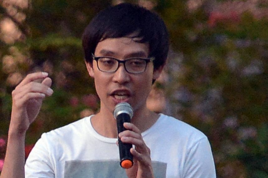 Mr Roy Ngerng, a blogger, speaking at the Labour Day protest at Hong Lim Park on May 1, 2014. -- PHOTO: ST FILE