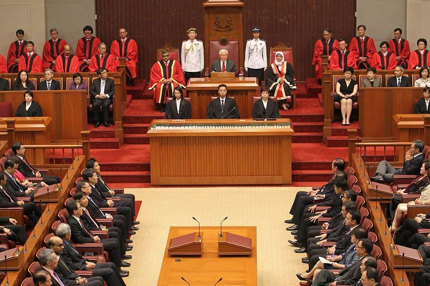 President Tony Tan Keng Yam (centre), flanked by Speaker of Parliament Halimah Yacob (right) and Chief Justice Sundaresh Menon (left), delivering his address at the opening of the second session of the 12th Parliament on 16 May 2014. -- PHOTO: ST FIL