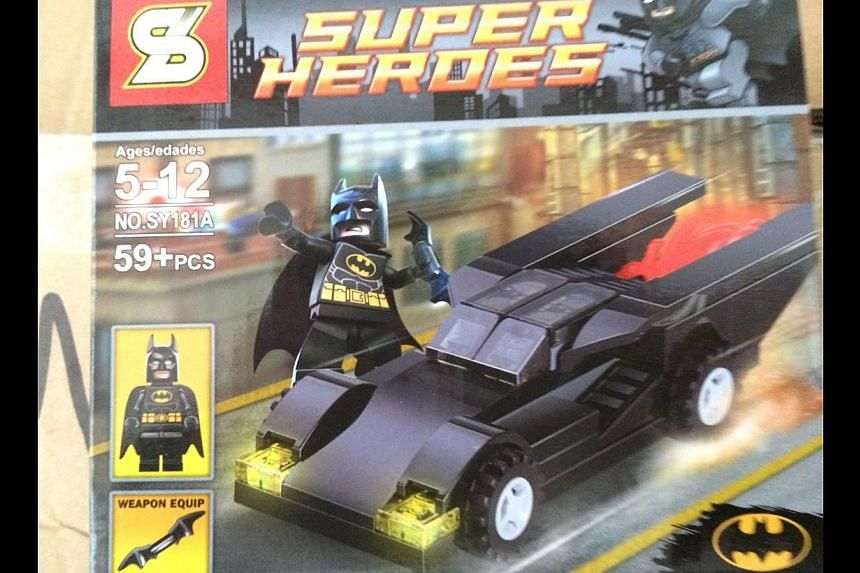 Singapore Customs enforcement officers found 159 cartons and nine sacks containing an assortment of toys, water bottles, bags and accessories featuring popular superhero and comic characters such as Batman (above) in the container.-- PHOTO: SIN
