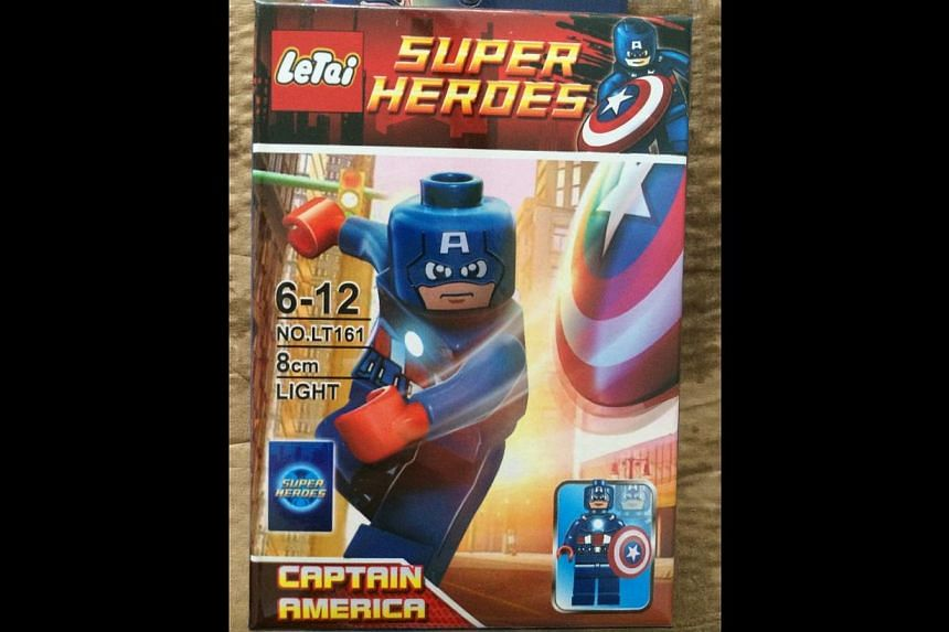 Singapore Customs enforcement officers found 159 cartons and nine sacks containing an assortment of toys, water bottles, bags and accessories featuring popular superhero and comic characters such as Captain America (above) in the container. -- P