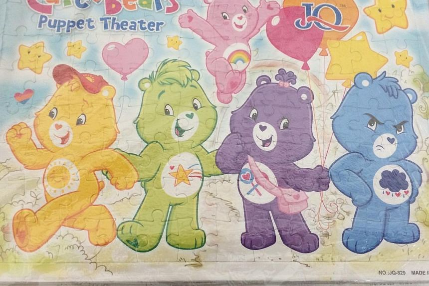 Singapore Customs enforcement officers found 159 cartons and nine sacks containing an assortment of toys, water bottles, bags and accessories featuring popular superhero and comic characters such as Care Bears (above) in the container. -- PHOTO: