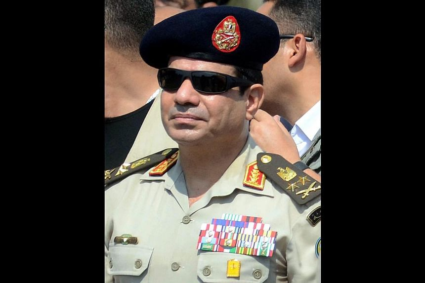 A Sept 20, 2013, file picture shows Egypt's then Defence Minister and military chief Abdel Fattah al-Sisi attending the funeral of Giza security chief Nabil Farrag in the district of Giza.The former general has scored a crushing presidential el