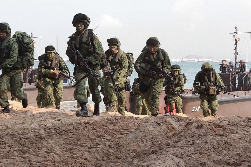 """Singapore Armed Forces (SAF) troops participate inExercise Golden Sand at Pulau Sudong on April 24, 2014. The Defence Ministry will go ahead with recommendations made by a high-level committee upon Government acceptance, despite the """"huge admin"""