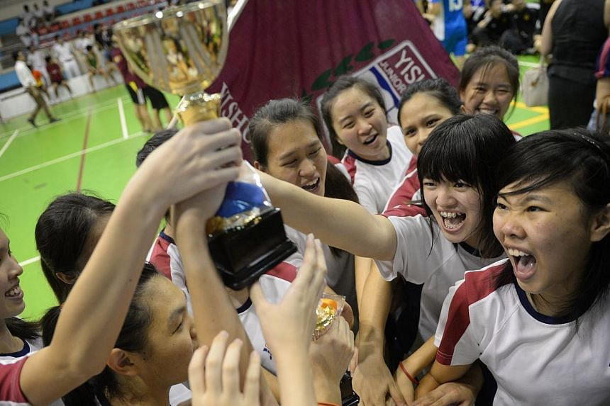 Yishun JC players celebrate after winning the final of the girls' Schools National A Division Floorball finalson Thursday, May 29, 2014.-- ST PHOTO:MARK CHEONG