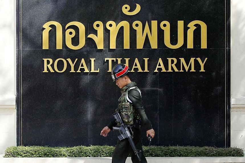 A soldier patrols around the Royal Thai Army Headquarters in Bangkok on May 29, 2014. -- PHOTO: REUTERS