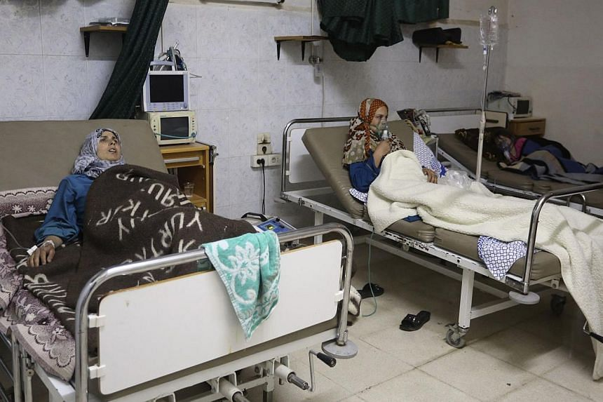 People, affected by what activists say was a gas attack, receive treatment inside a makeshift hospital in Kfar Zeita village in Hama. The destruction of Syria's chemical weapons arsenal will not be completed before a June 30 deadline agreed after Was