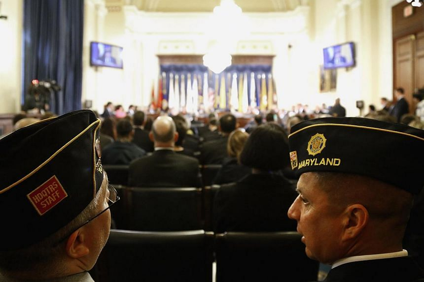 US military veterans listen in the audience during a House Veterans' Affairs Committee hearing on the Phoenix VA Health Care System wait list, on Capitol Hill in Washington on May 28, 2014. -- PHOTO: REUTERS