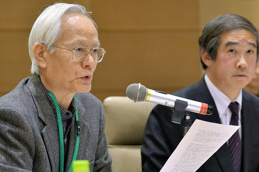 Japanese lecturers Yoshiaki Yoshimi (left), professor at Chuo University, and Hiroshi Hayashi (right), professor at Kanto Gakuin University, attend a gathering of academics and human rights activists in Tokyo on March 7, 2014. -- PHOTO: AFP