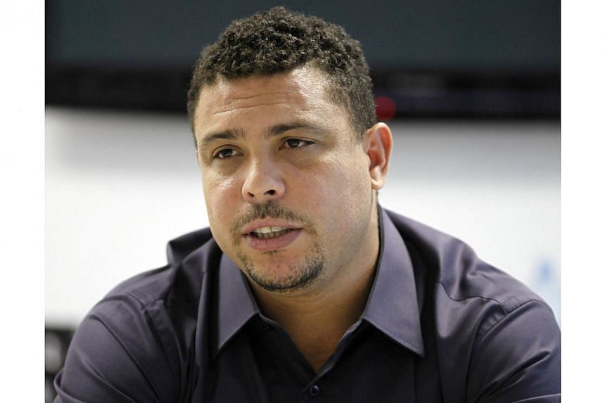 Brazil's former soccer player and member of the FIFA Local Organizing Committee Ronaldo gestures during an interview with Reuters in Sao Paulo on May 23, 2014. -- PHOTO: REUTERS