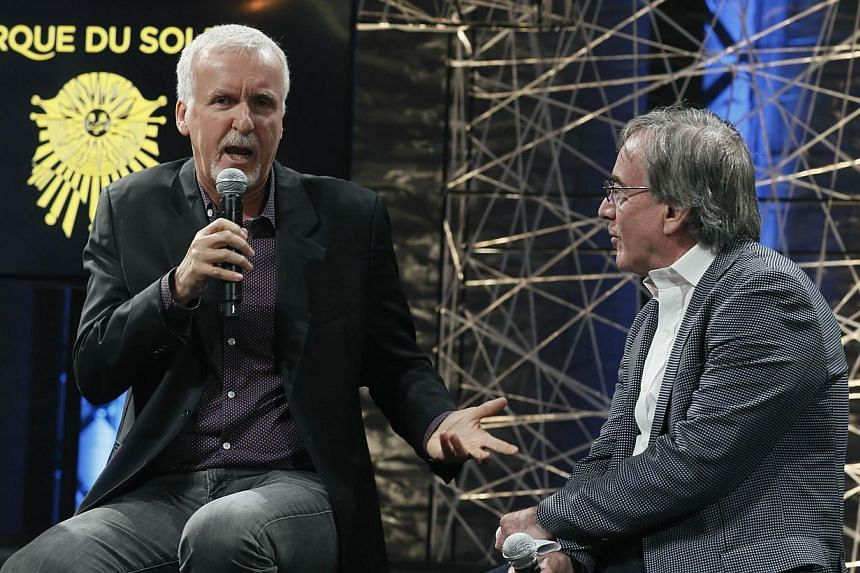 Film director James Cameron (left) and Cirque du Soleil's president and CEO Daniel Lamarre speak during a news conference in Montreal, Quebec, on May 29, 2014. Cameron announced a partnership with Cirque du Soleil to develop an arena-touring show ins