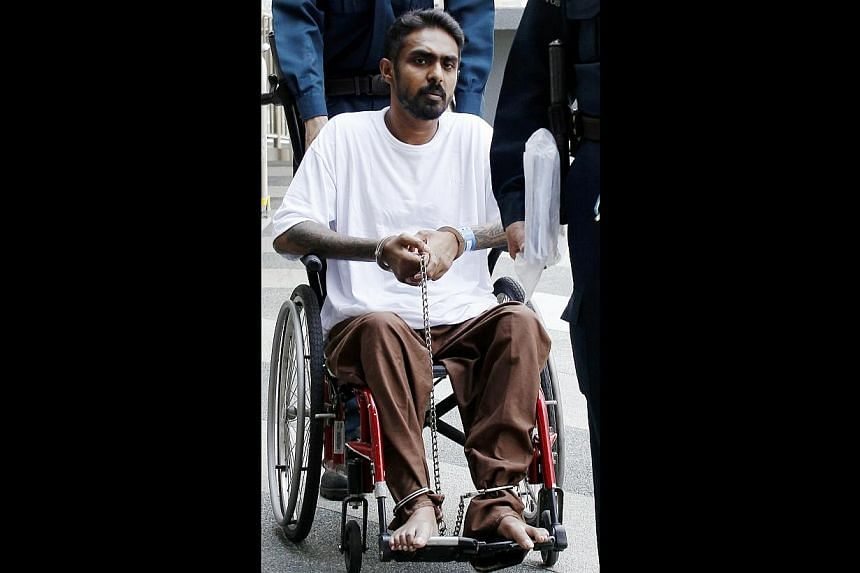 Two men, Easudas Jason (pictured) and Saravanan Uthasverian,were on Friday, May 30, 2014, sentenced to jail terms and caning over a conspiracy to extort money from victims, using a fake online advertisement for social escort services. -- ST PHO