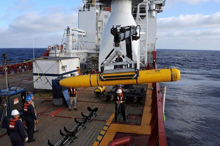 Crew aboard the Australian Defence Vessel Ocean Shield move the US Navy's Bluefin-21 into position for deployment in the southern Indian Ocean on April 14, 2014, to look for the missing Malaysian Airlines flight MH370 in this picture released by th