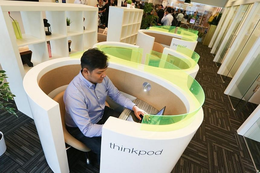 """Mr Abdullah Hafidz Bin Bujang, 30, a regular user of the Regus office space, such as this """"thinkpod"""".Companies and entrepreneurs without office space can now work out of business centres that have opened in three libraries - Toa Payoh, Geylang"""