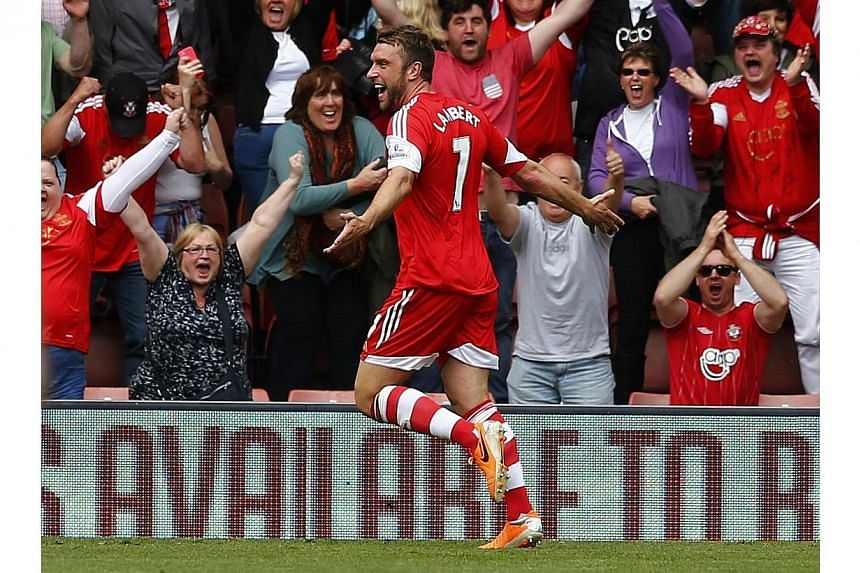 Southampton's Rickie Lambert celebrates after scoring against Manchester United during their English Premier League match at St Mary's Stadium on May 11, 2014. Lambert is set for a medical at Liverpool on Saturday after a fee of £4 million (S$8