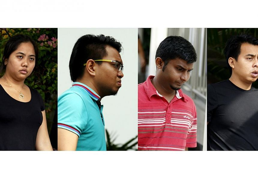 Malaysians (from left) Roslina Mohd Bakri, Raja Abdul Hadi Raja Rozhan, Haridass Manorahan and Norkhaizan Jelani were sentenced to a week in jail each on Friday, May 30, 2014, for disorderly behaviour outside Jalan Besar stadium on May 20, with