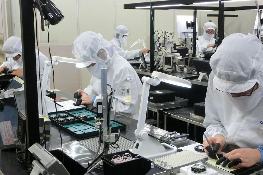 Japanese industrial output fell 2.5 per cent in April, government data showed on Friday, as companies cut back on production after ramping it up to meet a rush in demand ahead of an increase in the national sales tax from April. -- PHOTO: ST FILE