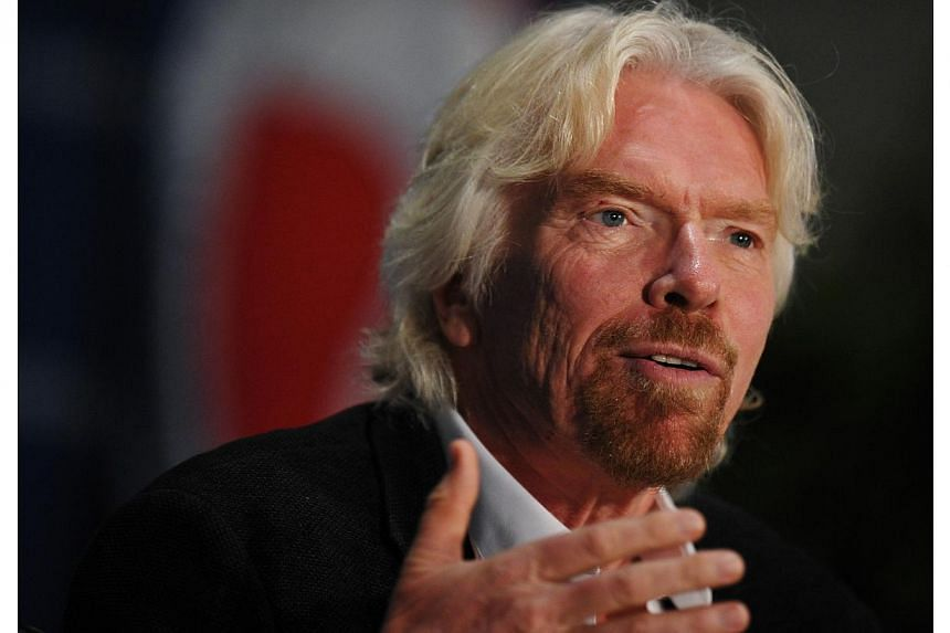 Sir Richard Branson, Founder, Virgin Group, speaks during the 13th annual Aviation Summit at the Walter E. Washington Convention Center on April 3, 2014 in Washington, DC. -- PHOTO: AFP