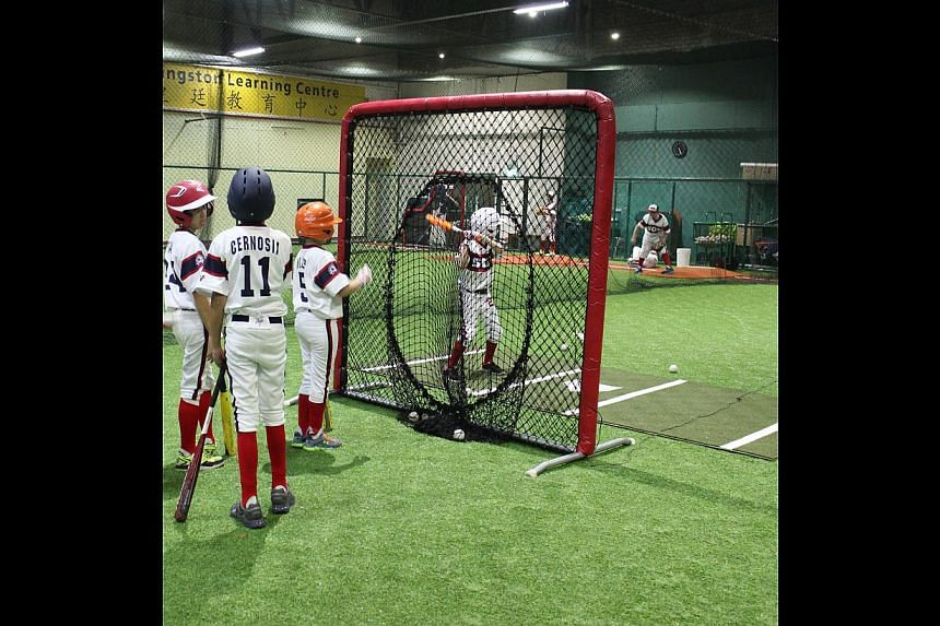 Children practising in a baseball batting cage at The Hit Factory. -- PHOTO: THE HIT FACTORY