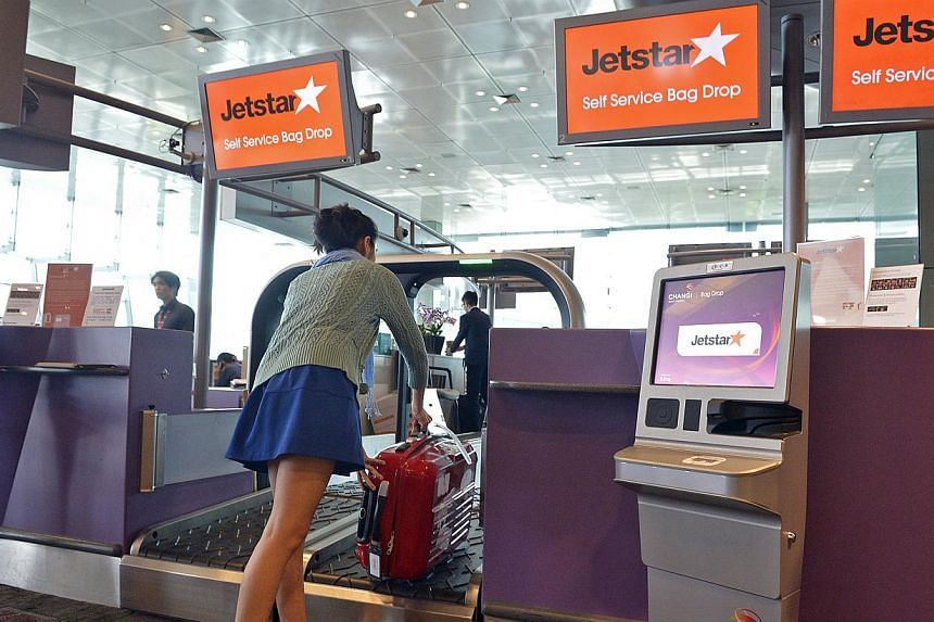 (Clockwise from top left) The Jetstar passenger just has to print out the luggage tag at the kiosk, attach the tag to the bag and drop it off at the designated area.