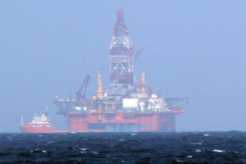 The Chinese oil rig Haiyang Shiyou 981 in the South China Sea. Monday's sinking of a Vietnamese fishing boat in contested waters is a consequence of a dangerous game of cat-and-mouse.