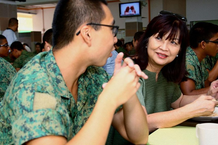 Dr Luisa Lee having lunch with SAF recruits. She served as a volunteer medical officer in the SAF for 20 years and is able to share her experiences with her grandchildren, who are now doing national service.