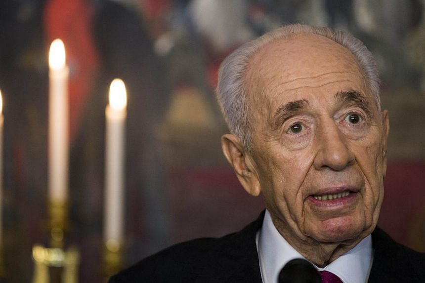 Israel's President Shimon Peres answers questions at a press meeting on the first day of his official visit in Oslo on May 12, 2014. -- PHOTO: AFP