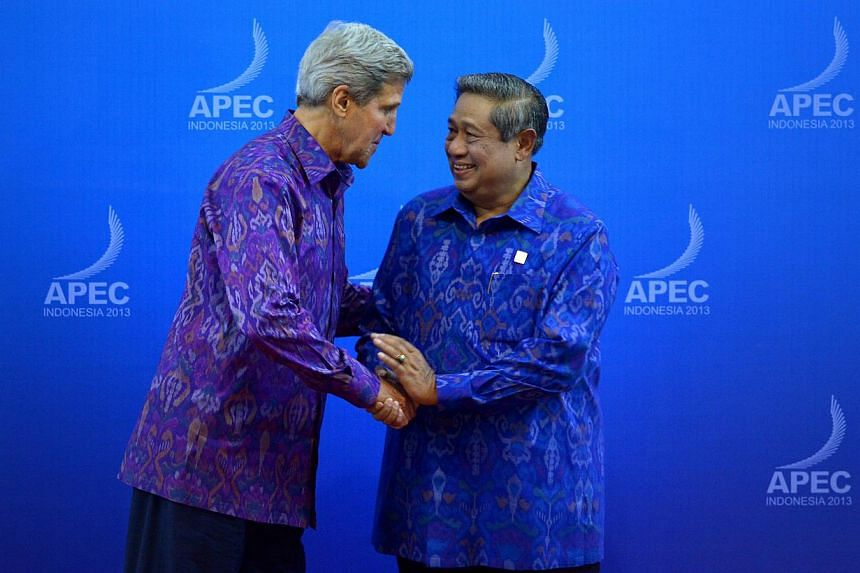 John Kerry (left), US Secretary of State, being greeted by President of Indonesia, Dr Susilo Bambang Yudhoyono, before the gala dinner held at the Bali Nusa Dua Convention Centre during the Asia-Pacific Economic Cooperation (APEC) Leaders' Week 2013