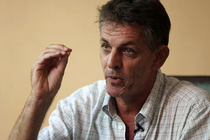 Pierre Legros, former husband of Cambodian activist Somaly Mam who is known globally for her fight against sex trafficking, gestures during an interview with Reuters in Phnom Penh on May 29, 2014. -- PHOTO: REUTERS