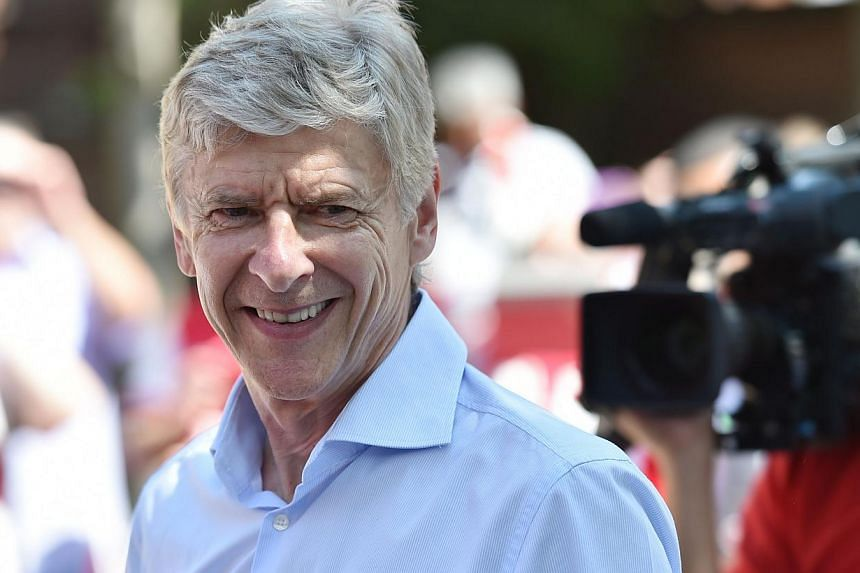 Arsenal manager Arsene Wenger has agreed a three-year contract extension, keeping him at the club until 2017, the BBC reported on Friday.-- PHOTO: AFP