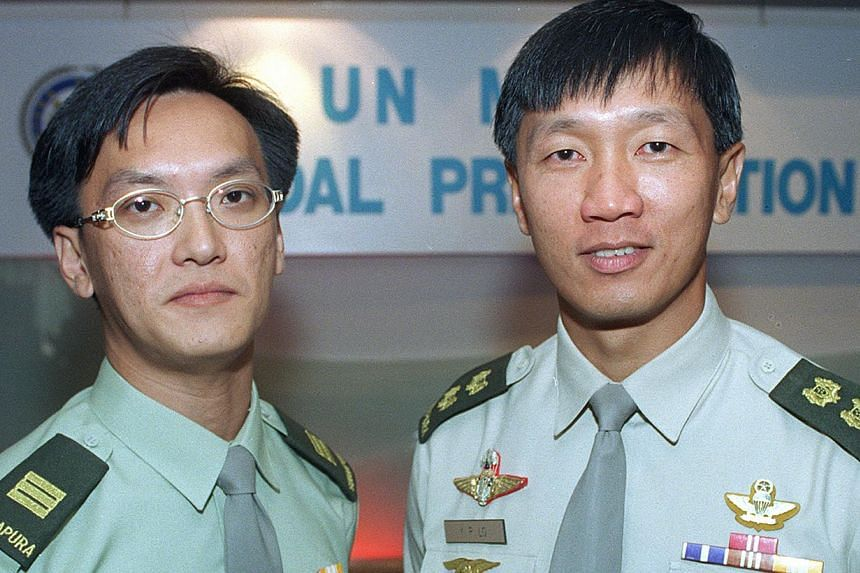 Lieutenant-Colonel Lo Yong Poo (right) and Captain (NS) Kok Yin Khong were awarded the SAF Medal for Distinguished Act, becoming the first SAF personnel participating in United Nations missions to receive the medal.-- PHOTO: ST FILE