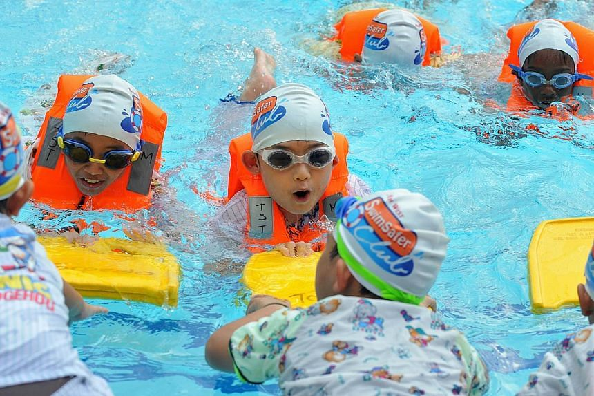 Children displaying water safety skills at the launch of the North West SwimSafer Clubs at Senja-Cashew Community Club in Bukit Panjang on Jan 29, 2011. In a first-ever deal between a corporation and a national water safety programme, national s