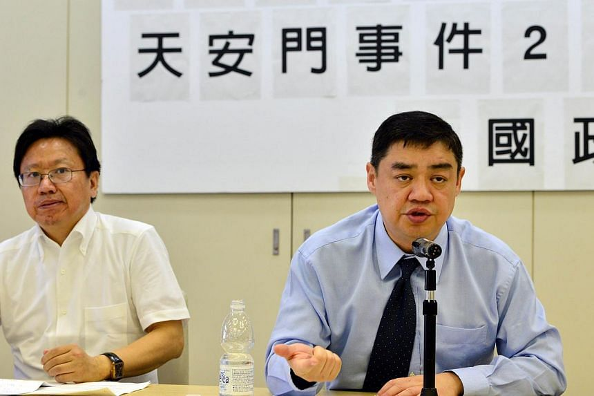 Former Chinese dissident leader Wu'er Kaixi (R) speaks at a seminar for the 25th anniversary of the 1989 crackdown at Tiananmen square in Tokyo on May 30, 2014, while Chinese author Chen Pokong (L) looks on. China's pro-Democracy activists, including