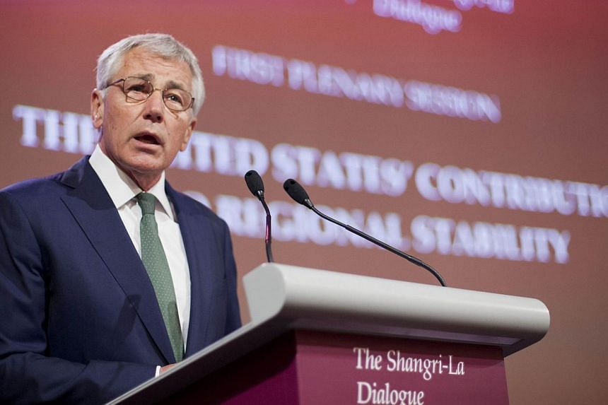 US Defence Secretary Chuck Hagel speaks at the opening plenary meeting at the 13th Asia Security Summit in Singapore, on May 31, 2014. -- PHOTO: REUTERS