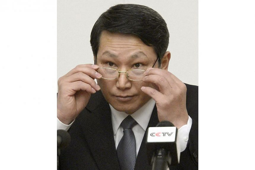 South Korean missionary, identified by the North as Kim Jong Uk, adjusts his glasses during a news conference in Pyongyang on Feb 27, 2014 file photo provided by Kyodo. North Korea sentenced Kim Jong Uk to life with hard labour on May 30, 2014 after