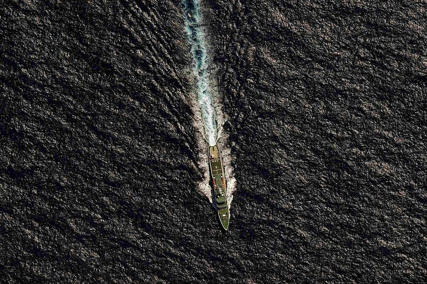 The Chinese Maritime Safety Administration (MSA) vessel Hai Xin 01 is seen from a Royal New Zealand Air Force (RNZAF) P-3K2 Orion aircraft in the southern Indian Ocean, as the search continues for missing Malaysia Airlines flight MH370 on April 13, 2