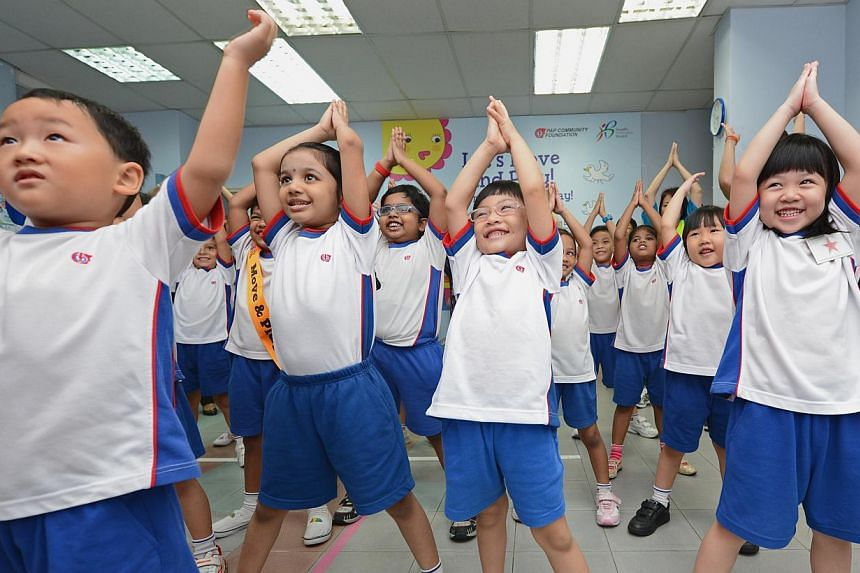 K2 pupils from Tanjong Pagar-Tiong Bahru PAP Community Foundation (PCF) kindergarten exercising in class. People interested in a first-hand experience of pre-school jobs can join a traineeship programme launched today.  -- PHOTO: ST FILE